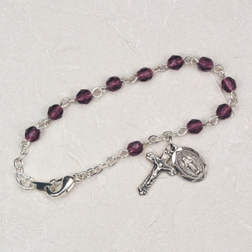The charm features a St Theodora medal The Crucifix measures 5//8 x 1//4 Silver Plate Rosary Bracelet features 6mm Topaz Fire Polished beads Patron Saint